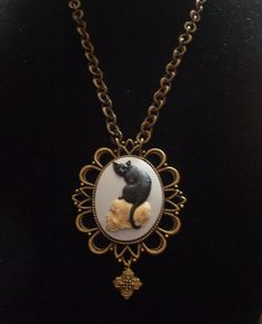 Black cat on a skull cameo goth necklace by MidnightDesires, $15.00