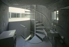 Japanese architects Yuji Nakae, Akiyoshi Takagi and Hirofumi Ohno have collaborated on NE apartments, a block of eight apartments for motorcycle enthusiasts in Tokyo. Above photograph © Hiroyasu Sakaguchi The C-shaped apartment block features a circular courtyard that allows residents to rotate their motorbikes. Above photograph © Hiroyasu Sakaguchi Here's some info from the architects:
