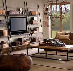 Love the three floor-to-ceiling shelves with the television in the middle. Another great idea for a focus wall.