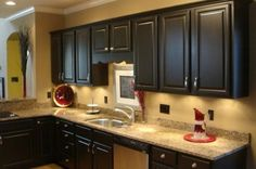 See? Gloss black. This site has a list of how-to steps for painting your own cabinets. :)