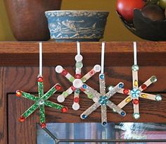 snowflake xmas ornament w/gems, buttons, glitter, and jewels. made from Popsicle sticks diy
