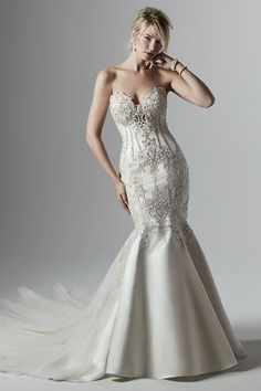 """""""Bead embroidered lace motifs featuring Swarovski crystals waltz over this dramatic Carlo satin wedding dress, sweetheart neckline, and illusion plunging back with exposed boning. European Wedding Dresses, Stunning Wedding Dresses, Wedding Dress Trends, Perfect Wedding Dress, Wedding Dress Styles, Beautiful Gowns, Bridal Dresses, Fit And Flare Rock, Fit And Flare Skirt"""