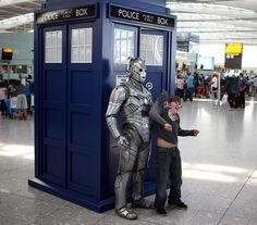 Doctor Who took over Heathrow Airport for its anniversary, and there are some lovely photos of a Cyberman wandering the airport like a lost traveler. and conducting the philharmonic orchestra. Heathrow Airport, Conductors, Tv On The Radio, Tardis, 50th Anniversary, Orchestra, Doctor Who, Celebrities, Lost