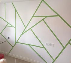 (SH: Pattern inspiration - not suggestion to actually do it straight on the wall) White wall covered with Frog Tape