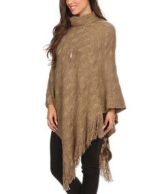 BellaBerry USA Khaki Geometric Asymmetric-Hem Cowl Neck Poncho | zulily  . $24.99 Compare at $90.00 size: size chart One Size Product Description:  Add a just-right layer of warmth to your cool-weather ensembles with this cozy poncho boasting a subtle pattern and elegantly flowing asymmetrical hem. A bevy of fringe adds visual charm to this easy-to-layer piece.      39'' long from high point of shoulder to back hem     100% acrylic     Hand wash; hang dry     Imported