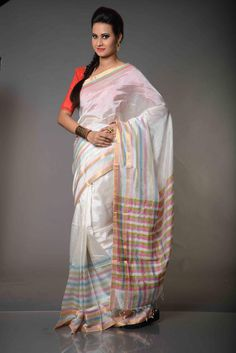 Chandralekha Multicolour Striped Mangalgiri Silk Cotton Saree : On a plain white background, beautiful interplay of horizontal and vertical lines running through the sari forming beautiful small check patterns in a hue of colors, Chandralekha Multicolour Striped Mangalgiri Silk Cotton Saree is a bequeathal of Mangalgiri Sarees. An authentic Mangalgiri Silk Cotton Saree, this one is woven with silk in warp and cotton in weft.