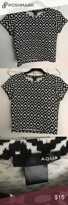 AQUA patterned crop top. Size Sm, worn once. Stretch poly Aqua by Bloomingdales crop top black and white patterned shirt. Looks great with high waisted jeans or skirt! Size small and in great condition. Aqua Tops Crop Tops
