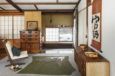 This Japanese home has traditional furniture, rice paper screens, green walls and exposed ceiling beams. George Nakashima rugs designed in 1959 and now released by Edward Fields.