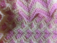 Baby blanket made with hearts on front side, and zig zag pattern on back side, looks like two blankets in one