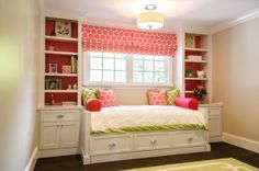 Full-sized day bed under windows with book shelves on either