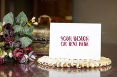 White Card on a Table with Flowers by ILoveMockupDesign on @creativemarket