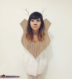 I made the mount from cardboard and drew a wood grain on it. The antlers are just found twigs tucked into a headband.