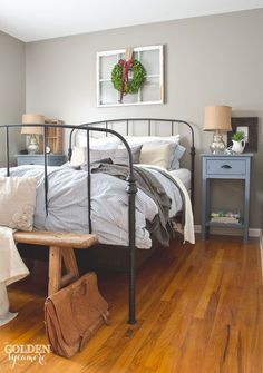 Black iron Ikea bed frame in rustic cottage bedroom - thegoldensycamore.com #MasculineBedding