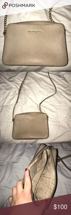 Michael Kors Jet Set Crossbody Used once. Practically brand new. One spot on bag as pictured on the back corner. Taupe color Michael Kors Bags Crossbody Bags