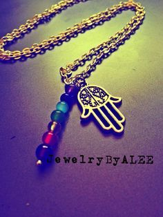 Hamsa hand chakra necklace on Etsy, $27.00