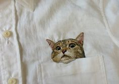 funny embroidery of a cat on pocket