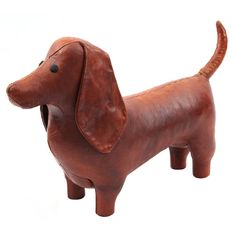 bercrombie & Fitch Leather Dog Ottoman  United Kingdom  1950's  Abercrombie and Fitch leather dachshund ottoman circa 1950's. This example has a wonderful patina to the leather and can be used as a sculpture or foot stool.