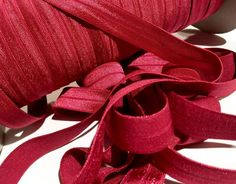 """Light burgundy 5/8"""" fold over elastic FOE. For making baby headbands, barefoot baby sandals, sewing cloth diapers, lingerie & more."""