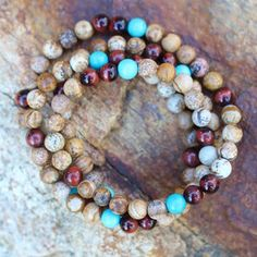 How do you feel when you look at these stones?  Peaceful. Happy. Energetic.  Picture Jasper. Tigereye. Turquoise.  Imagine what it feels like to hold them! Shop our online store for more gemstone combos like this one or create something unique to you with our custom design options