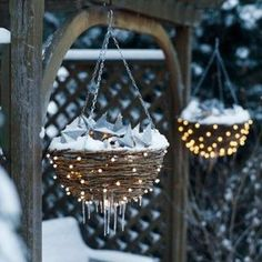 Hanging basket winter decor, I love the light's in the baskets. I am going to miss the snow.