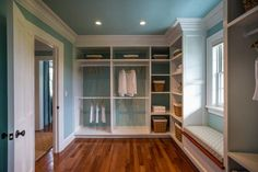 Wow-Worthy Closet Design -- Spacious and luxurious, the oversized walk-in master closet provides ample storage for year-round wardrobes. Custom-built shelving and crown molding draws attention to the thoughtful craftsmanship that takes this closet design to the next level.