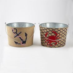2 styles. Handled tin beverage tubs feature crab and anchor printed burlap exterior. May be used as a gift 'basket' or to hold ice and drinks.
