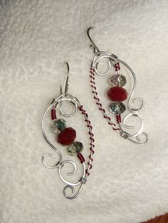 Interesting use of colored wire  Oxblood red crystals and silver wire wrapped-deZigns by sanDra