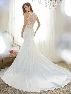 Image from https://moncheribridals.com/wp-content/uploads/2014/12/Y11566_bk_Designer-Wedding-Dresses-2015-350x467.jpg.