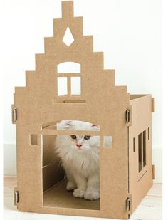 These cardboard houses have been especial designed for cats. The cats are going to love this cute cardboard boxes. Isnt that the ultimate cardboard box for cats? Cat Mansion, Dog Room Decor, Pet Decor, Cat Castle, Design3000, Cardboard Playhouse, Cardboard Art, Cat Basket, Cat Tent