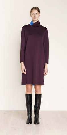 MARIMEKKO ALTAIR DRESS - DARK WINE RED  This dress has a funnel neck and blue interior made of double knit viscose jersey. Its raw edges are hemmed; a hint of blue shows at the side seams. The straight cut silhouette falls to an above-knee hemline.  #pirkkoseattle #seattle #pirkkofinland #purple #bue #turtleneck #funnelneck #jersey #business #play
