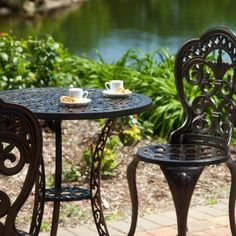 Wrought iron chairs with upholstered cushions at an outdoor seating ...