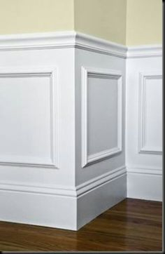 Buy cheap picture frames. Paint and glue to wall...