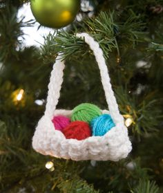 Red Heart: Crochet Basket Ornament - free pattern by Randy Cavaliere Crochet Christmas Decorations, Christmas Crochet Patterns, Crochet Ornaments, Holiday Crochet, Crochet Gifts, Christmas Crafts, Crochet Food, Christmas Knitting, Crochet Basket Tutorial