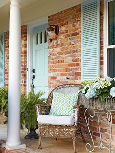 BHG:  Shutters and a front door painted in a pale aqua hue create a different look and feel for this home. No longer does it feel like a 1970s ranch; instead it looks like a little cottage, which is a reflection of its interior.