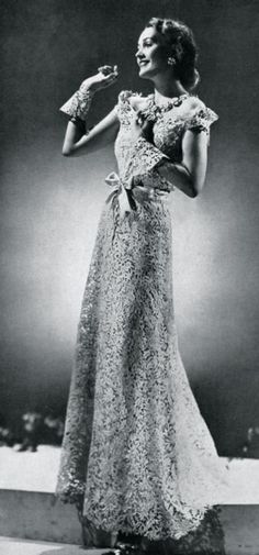 A beautiful gown which is elegant, sophisticated and chic. Everything that sums up CHANEL. This CHANEL was taken in 1938. Beautiful gowns with great detail. A-line gown which most were throughout the 1900's.