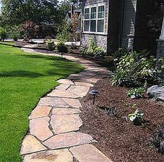 Flagstone border. Use walkway as a border for landscaping