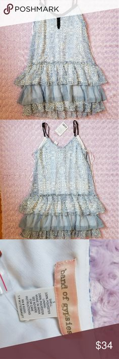 "Urban Outfitters Band Of Gypsies Dress Blue S NWT Urban Outfitters Band Of Gypsies Dress Blue White Black Ruffle Spaghetti Strap Size S Flat measurements: Chest 16"" Waist 18"" Length 31"" Band of Gypsies Dresses Mini"