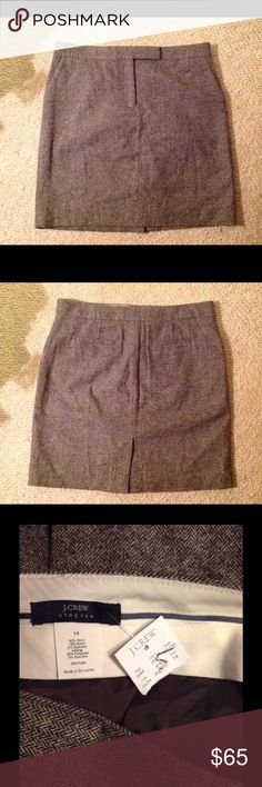 """J. Crew Black White Herringbone Tweed Skirt 14 Very nice j. Crew skirt. Black and white herringbone pattern. Wool Stretch Blend in size 14"""" Fully lined. Straight style with a back slit. Brand new with tags. Waist 37"""" Hips 44"""" Length 21"""" J. Crew Skirts"""