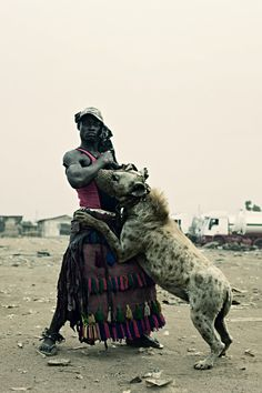 una-sirena-en-el-desierto:    blackfashion:    From the Hyena Men photo series by Pieter Hugo. Taken in Nigera.    Um, who is bad ass? THIS GUY! And hot, to boot!