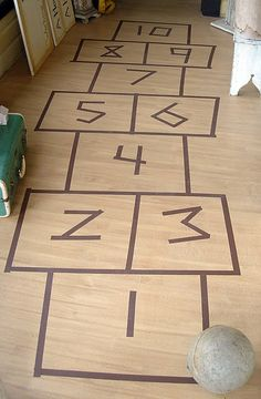 Indoor hopscotch.... using tape.... I love it, great for unexpected touch of whimsy in the playroom, or child's room, or for a birthday party that lands on a rainy day, or for adults.... free, fun, I loved this game as a child...