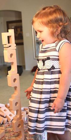 Stacking at its finest! How high can she stack SumBlox as she exercises her curiosity and fine motor skills? Learning starts early and it sure is fun!