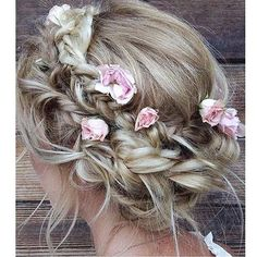 Weddings and flowers are a match made in heaven and this hairstyle inspiration is surely perfect for any wedding! Incorporating a braided chignon with hair twist on the side and pink roses placed here and there, this hairdo is such a stunner! Who loves this idea? Show some love!  Image via @caitlyn.nelson