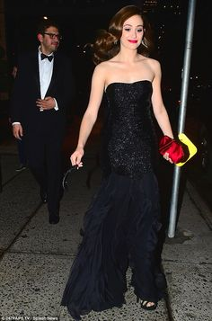 Emmy Rossum oozes glam in dramatic black gown for date night #dailymail