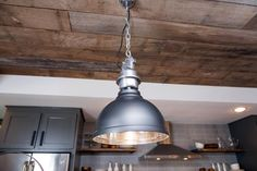 Fixer Upper Season 3 -- A Fixer Upper for a Most Eligible Bachelor Kitchen, Detail. The light fixtures over the double island in the kitchen of the newly renovated Ridley home, as seen on Fixer Upper. Fixer Upper Kitchen, Industrial Pendant Lights, Rustic Industrial, Rustic Modern, Rustic Wood, Kitchen Upgrades, Kitchen Ideas, Kitchen Designs, Modern Ranch
