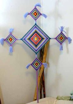 "Traditional-style Huichol native design, made by artist Jay Mohler. The Huichol of central western Mexico call these Sikuli, which means ""the power to see and understand things unknown."" They carry great spiritual significance & are placed in religious shrines & other sacred places. The four points represent the elemental processes of earth, fire, air, & water, & the four cardinal directions.  #Ojos_de_Dios"