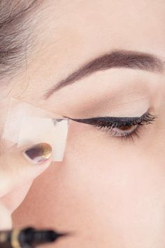 The Scotch-Tape trick for the perfect liquid liner cat's eye: Step 5