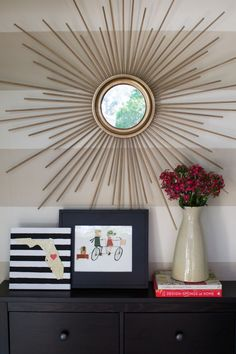 This link is for a DIY Gold Sunburst Mirror…but I like the black & white striped board w/ the wooden state affixed to it. This is something I'll probably do for my own home. :)