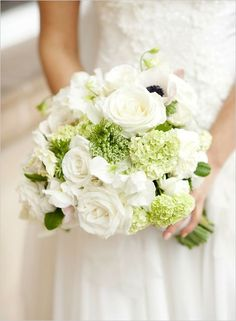 Brilliant suite of blooms in this bouquet including white roses, anemones, and sweet peas with green snowballs and accented with Queen Anne's lace.