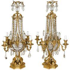 Artefactos de luz y accesorios con apliques de cristal de bacara en dorado www.larueda.com
