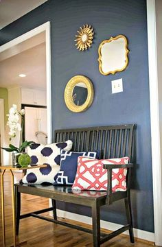 Wall color is Hale Navy by Benjamin Moore.  My favorite navy and it looks gorgeous in this space. like the yellow on the mirror...i may have to get some yellow too.